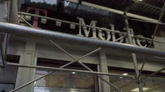 T Mobile store under scaffolding on Broadway in NoHo on gritty NYC day in 1080 - stock footage