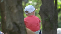 Little boy with hat in Central Park, Cluj-Napoca Stock Footage