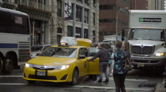 taxi driver getting into cab and closing passenger door trunk open, Manhattan NY - stock footage