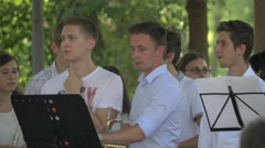 Getting ready to play the trumpets in the park, Cluj-Napoca - stock footage