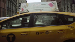 Taxis driving down Broadway - cars and cabs passing by quiet NYU street in NoHo Stock Footage
