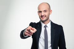 Atractive cheerful young business man in formalwear pointing on you - stock photo