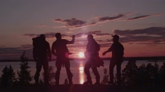 Men With Guns at Sunset. Shot with Red Camera Stock Footage