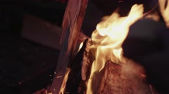 Man with Knife at Bonfire. Shot with Red Camera Arkistovideo