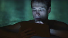 Man is using a tablet computer near a pool in a spa wellness center - stock footage