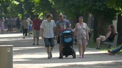 Parents with baby walking in Central Park, Cluj-Napoca Stock Footage
