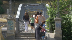 Walking on a pedestrian bridge over Somesul Mic River, Cluj-Napoca Stock Footage