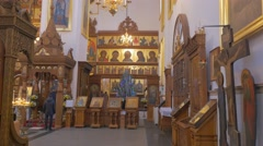 An Impressive Iconostasis and Golden Looking Icons Inside of an Old Orthodox Stock Footage