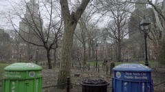 tilting down to recycling trash cans in Washington Square Park on cold gloomy NY - stock footage