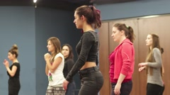 Training in Latin dances - a group of girls rehearsing movements Stock Footage