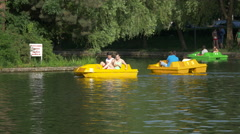 Pedaling the colored pedal boats from Central Park, Cluj-Napoca Stock Footage