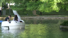 Pedaling swan pedal boats in Central Park, Cluj-Napoca - stock footage