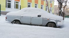 Car  under the snow in the yard. Dolly shot. Stock Footage