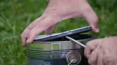 Man hands opening paint can. Stock Footage