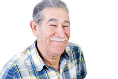 Authentic older Mexican man grinning Stock Photos