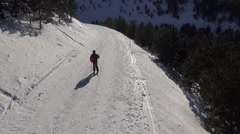 Following a skier on Mont-Ventoux, in the snow, aerial winter view from a drone Stock Footage