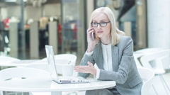 Exasperated businesswoman talking on the phone Stock Footage