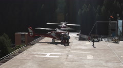 Passengers boarding helicopter Stock Footage