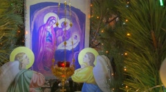 Saint Mary Icon in a Fir Tree of Orthodox Church and a Religious Man Praying Stock Footage