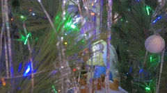 Christmas Fir Tree With Glass Baubles and Ornament as Well as Saint Mary Icon Stock Footage
