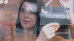 Small business owner opening shop Stock Footage