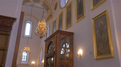 Golden Looking Icons, Chandeliers, Round Windows Inside of Christian Orthodox Stock Footage