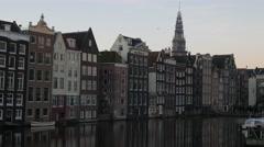 Damrak basin and De Oude Kerk - stock footage