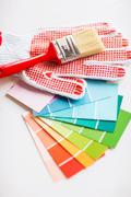 paintbrush, gloves and pantone samplers - stock photo
