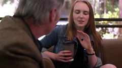 A student talking to her professor over coffee in a study room Stock Footage