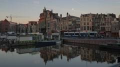 Pan across Damrak with the spire of De Oude Kerk - stock footage