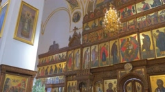An Impressive Iconostasis and Golden Chandelier, Which Decorate an Old Orthodox Stock Footage