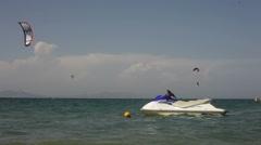 Kitesurfers ride on the beach. Stock Footage