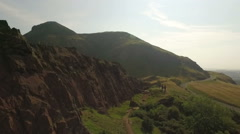 Aerial shot of Arthurs Seat, Edinburgh, Scotland from Calton Hill - stock footage