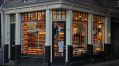 Exterior of a traditional Amsterdam cheese shop - stock footage