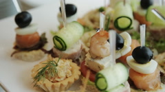 canapes snacks on a buffet table - stock footage