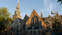 De Oude Kerk at dawn in Amsterdam. - stock footage
