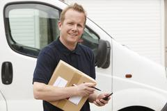 Courier Delivering Package Requiring Signature - stock photo