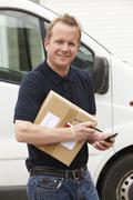 Courier Delivering Package Requiring Signature Stock Photos