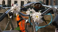 Flowers on the handlebars of an Amsterdam Bike Stock Footage