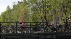 Cyclists and pedestrians cross the Huidenstraat Bridge Stock Footage