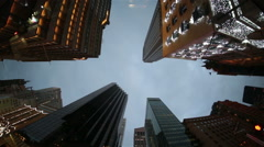 NYC midtown Manhattan 5th Avenue looking up skyscrapers winter sky christmas. - stock footage