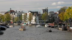 Wide view looking along the Amstel canal in Amsterdam Stock Footage