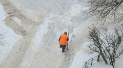Anonymous female worker cleaning dangerous pavement from ice. Stock Footage