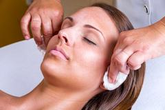Beautician face cleaning. - stock photo
