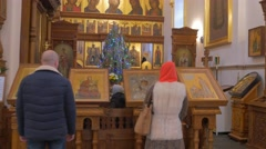 A Magnificent Iconostasis of an Orthodox Church and People Praying Before it on Stock Footage
