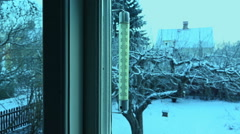 Thermometer outside a window. Cold and clear day in winter. Stock Footage