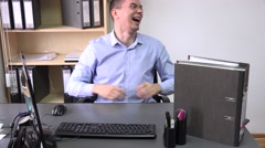 Overly joyful business man inside the office laughing, very happy, telling jokes Stock Footage