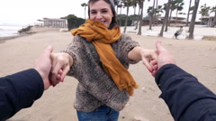 Young happy woman turning round on beach, super slow motion Stock Footage
