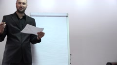 Business consultant presentation on flip chart of calculation annual sales 4K - stock footage