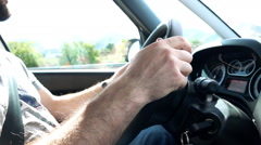 Car speedometer, driver behind the wheel, slow motion shot at  - stock footage
